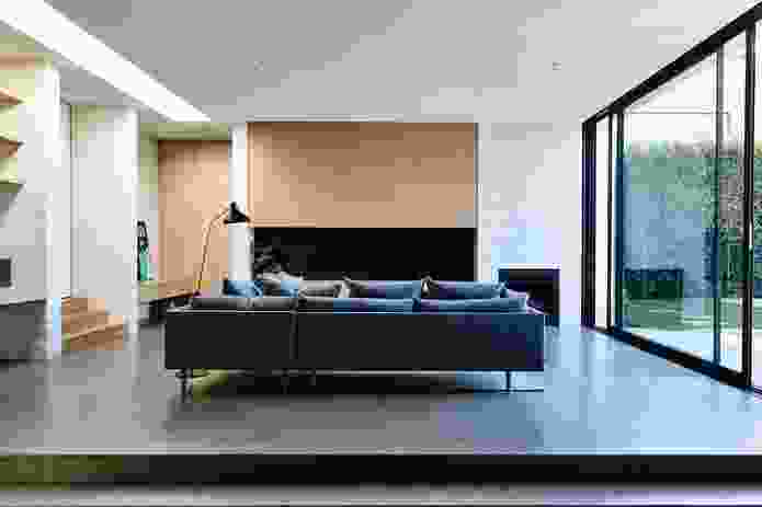The living room and main bedroom sit almost flush with the garden, allowing for a generous floor-to-ceiling height.