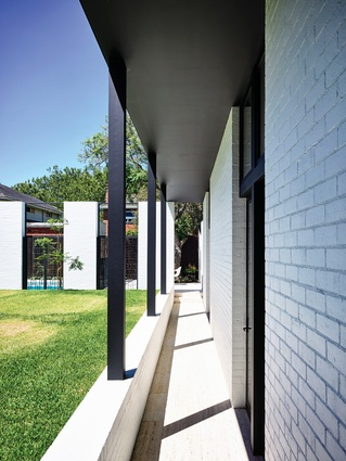 The children's bedrooms line up along the southern boundary to form a distinct wing.