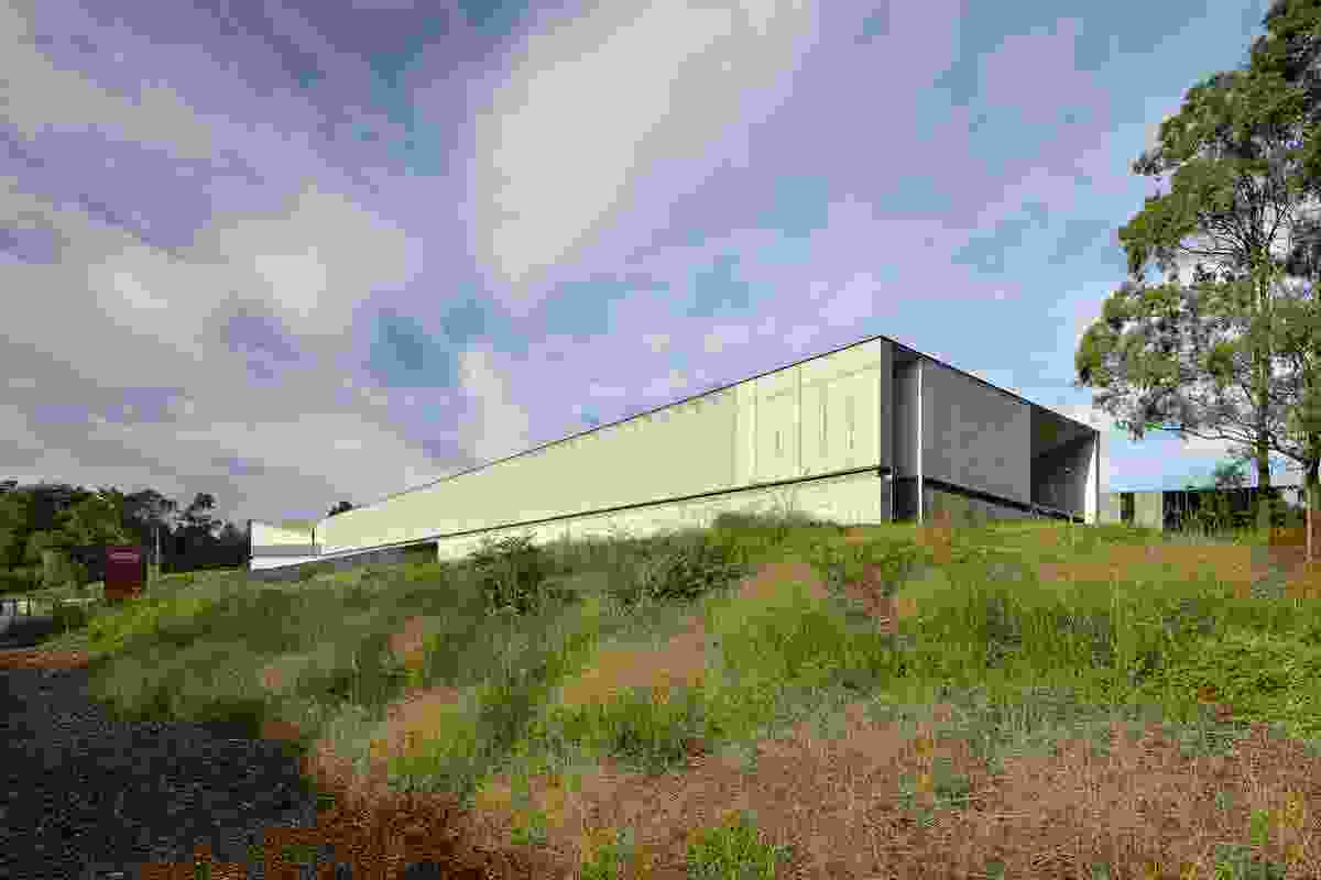 The PlantBank building first appears as a monolithic bunker in a natural landscape.