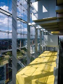 View from one of the main internal circulation balconies. The formal character of the building carries through into the interior spaces.