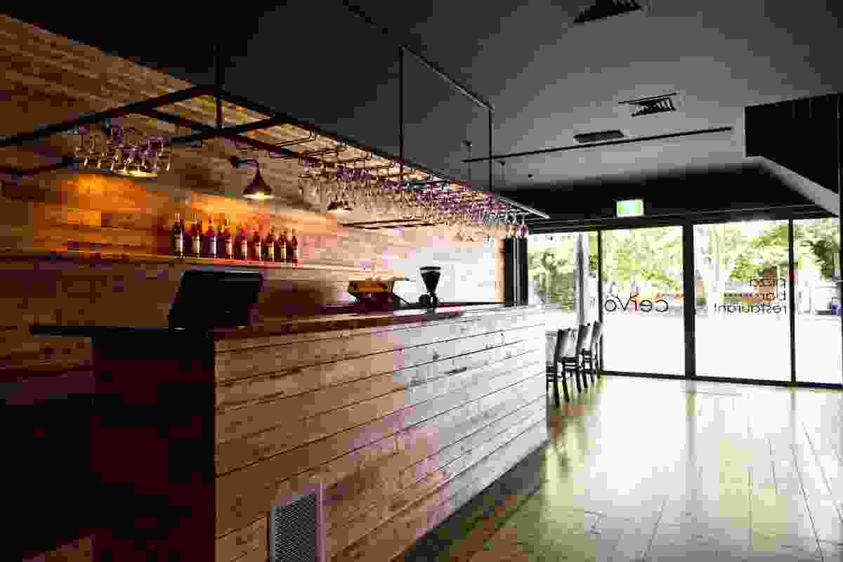 The recycled timber bar and matt blackceilings set the mood on arrival.