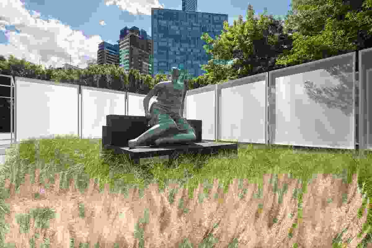 The Garden Wall installation by Retallack Thompson and Other Architects features a bed of spear grass surrounding Draped seated woman sculpture by Henry Moore.