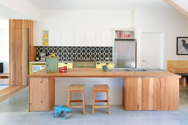 The kitchen bench can be used as a breakfast bar.
