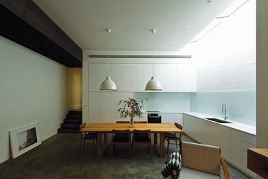 """A lowered """"bulkhead"""" corridor ceiling emphasizes the transition from the original house."""