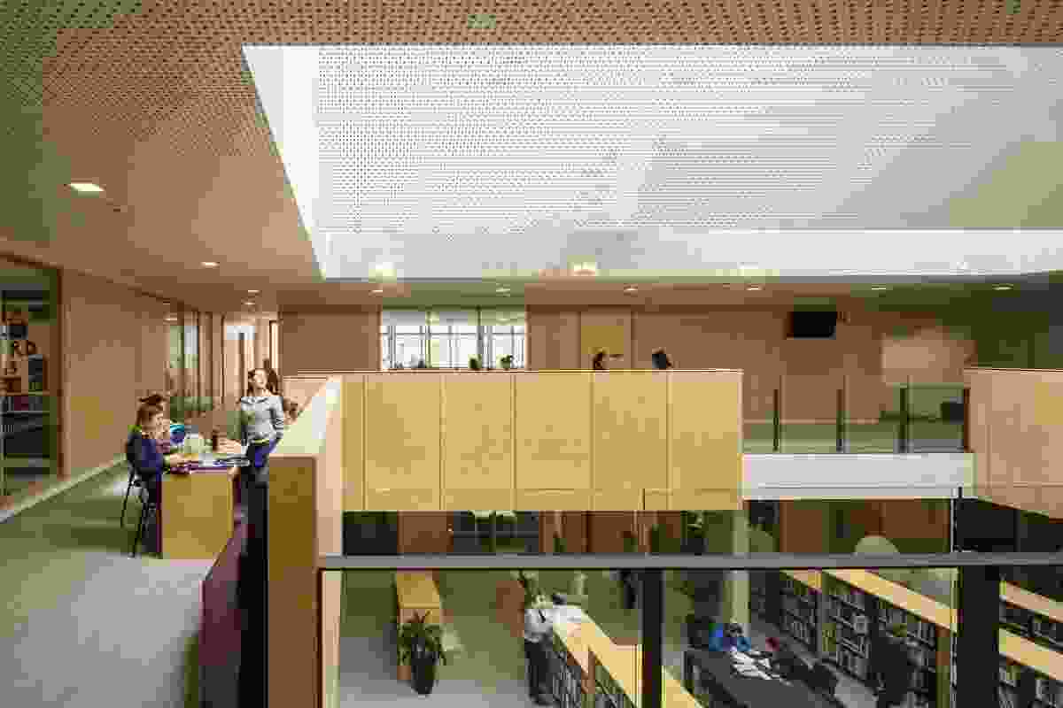 """The sky-lit double-height library is """"open and porous,"""" allowing for interaction with adjoining learning spaces."""