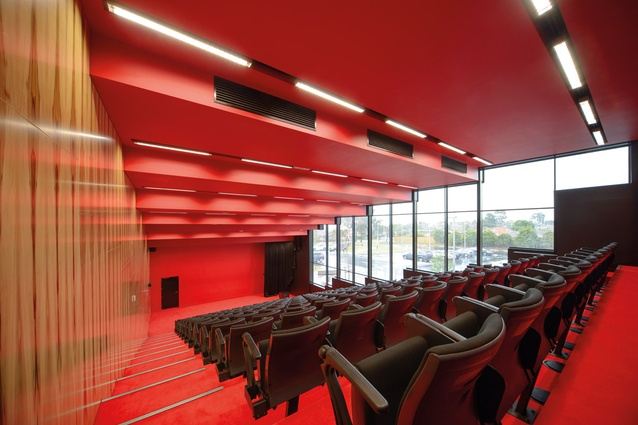 The red lecture theatre clad in Tasmanian blackheart sassafras timber.