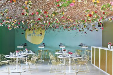 The attica pop-up restaurant on the second floor featured a stunning canopy of coppiced branches and roses in light bulbs, designed by Joost Bakker.