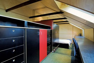 Roof Retreat – Formply joinery containing a cache of wardrobe items forms the ordered storage for the bedroom.
