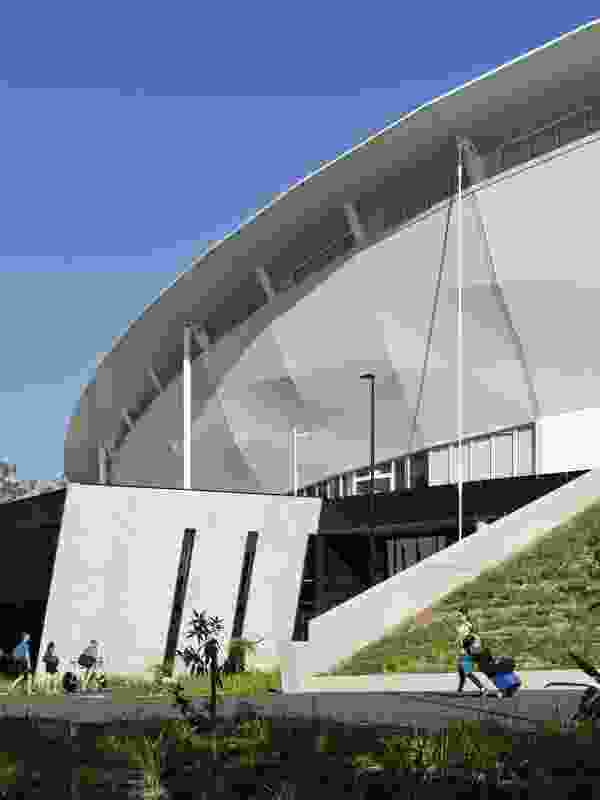 The main entry (pictured) is set into the sloping terrain, while other public entrances on higher ground allow direct access to the concourse level during events.