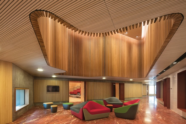 Australian materials recur throughout the project: the floor of the chancery lobby is made from Pilbara red stone and the elaborate ceiling showcases blackbutt.