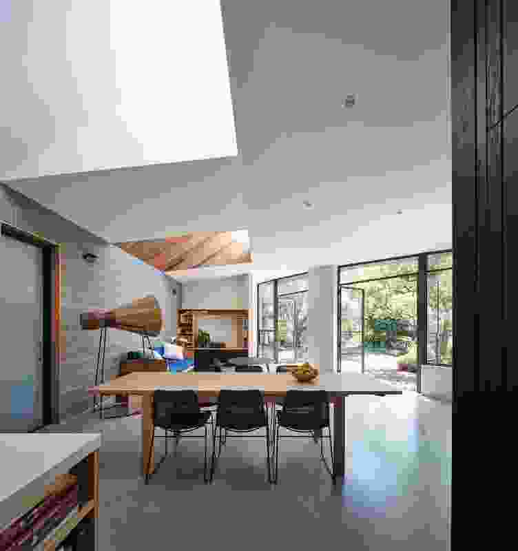 Roof pop-ups over the living area bring northern light deep inside the space, but also delineate zones within the open plan.