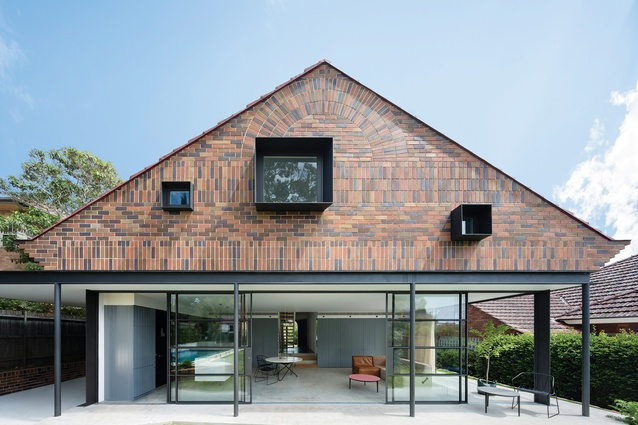"The rear elevation of the addition comprises a ""suspended brick tapestry"" over a lightweight pavilion."