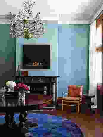 The moody hues of the blue walls provide a backdrop to a collection of antique furniture. Photograph: Anson Smart.