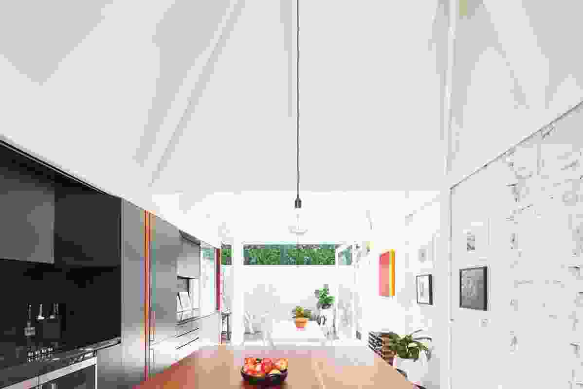 While the renovation adds little additional floor area, it radically reorganizes the house's interior to flood it with light.
