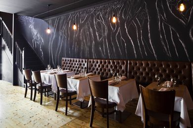 Leather banquettes are a nod the Italian tradition.