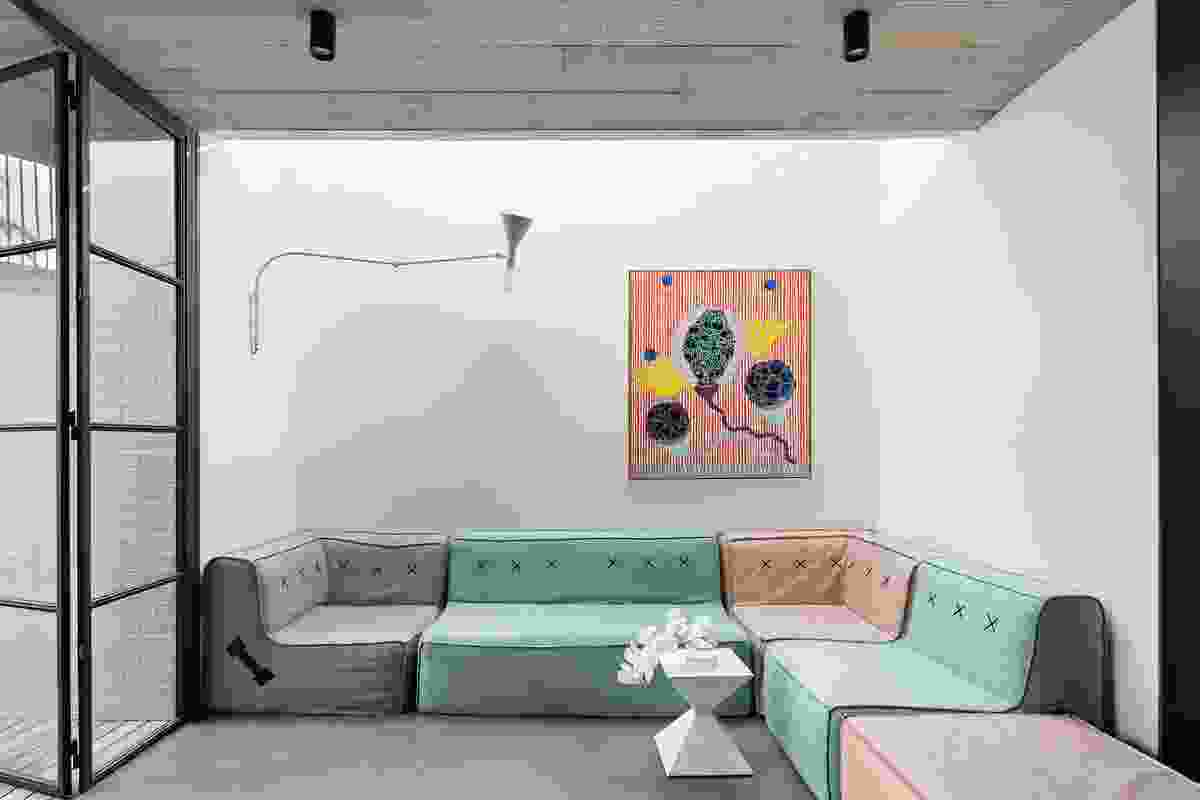 With its textured concrete and minimalist palette, the rumpus room has a raw, industrial feel. Artwork: Gabrijela Iva Polic.