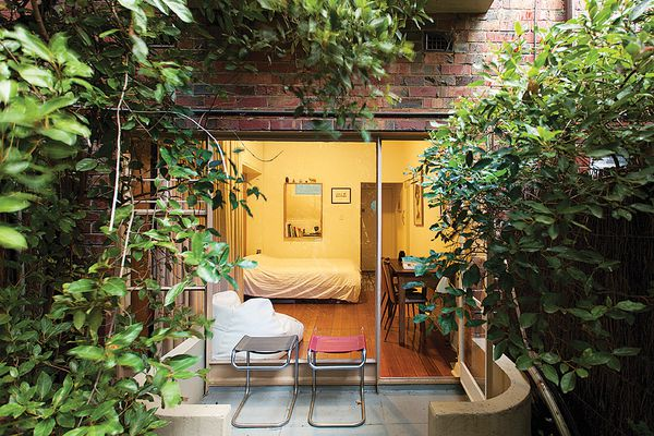 The connection between the small space and the existing courtyard is reinforced through subtle design interventions.
