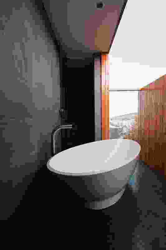 """The bathroom has a """"loo with a view"""" and connects to a tiny deck."""