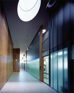 The corridor on the south side of the building that separates the plywood-clad microscope rooms and the research offices.