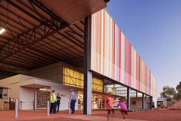 "With a nod to Learning from Las Vegas, a large barcode is painted on the exterior wall of the shed. When scanned, the lines of oranges and pinks say ""This is a Big Thing."""