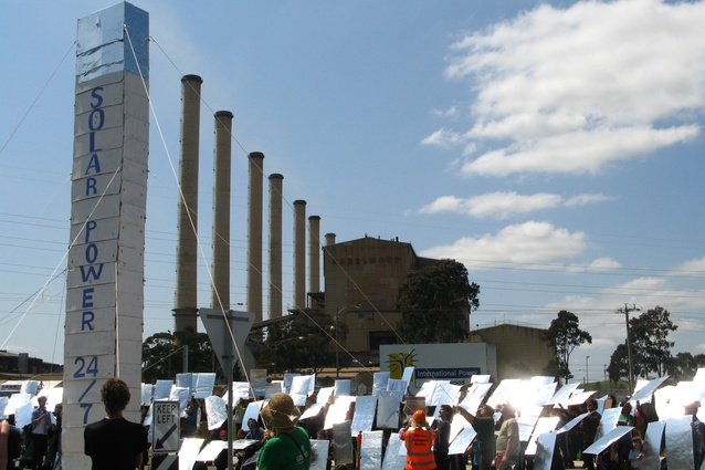 A human-made solar thermal mock power plant next to the Hazelwood coal-fired power station, Victoria, Australia, 2010.
