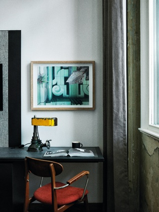 Each room features a table lamp by the rag and bone man and photographs of the former building by various photographers, including Nathanael Hughes (pictured).