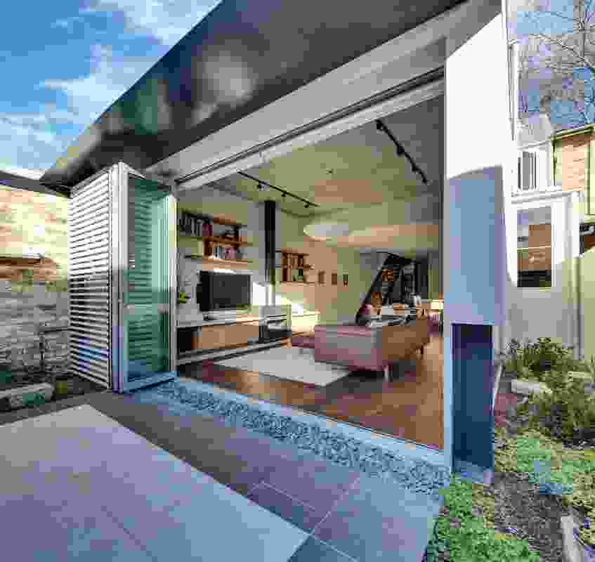 Bifold doors open onto a landscaped courtyard with a Japanese feel, albeit in an antipodean context.