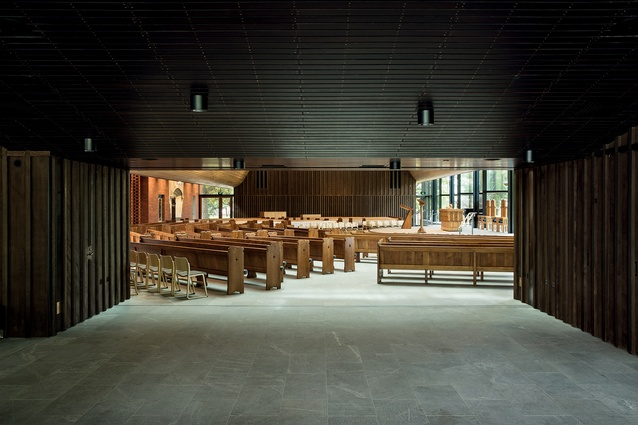 View from the foyer into the nave. Natural materials, both old and new, add warmth and drama to the interior.