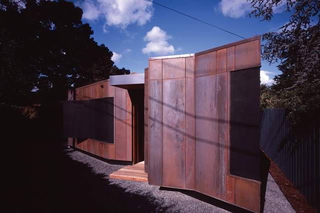 "Pre-weathered copper cladding hovers above the ground and defines the extension as a ""placed object."""