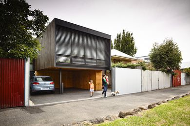 The extension raises living spaces from the existing house to capture views to the adjacent reserve and Melbourne city.
