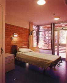 Patient bedroom with view across the verandah to the river.Image: Brett Boardman