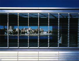View through the louvres, across the building, to the bay and city.