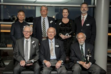 The 2016 DIA Hall of Fame inductees. Back row, L-R: Khai Liew, Winston Foulkes-Taylor (representing David Foulkes-Taylor), Joanne Cys and David Clark. Front row L-R: Ian Howard, Edward (Ted) Worsley and Langdon Badger. Absent: Aurelio (Ray) Costarella and Stuart Devlin.