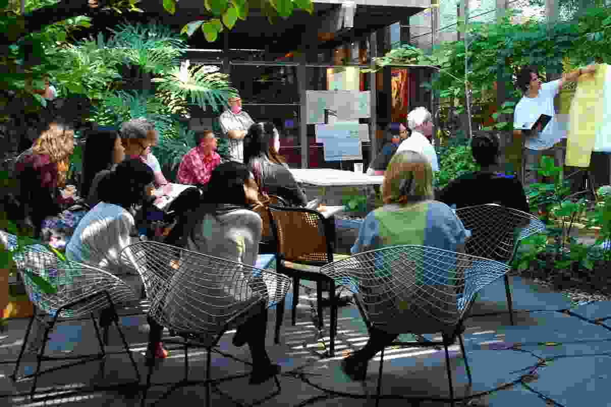 A crit session in the Walsh Street courtyard.