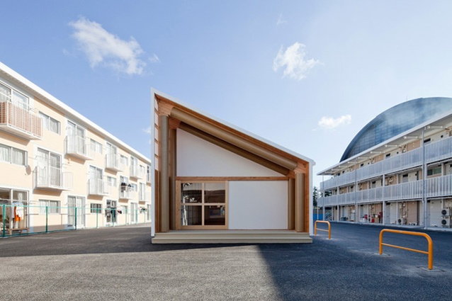 Atelier made with paper tubes and container shipping facades as part of Shigeru Ban Architects' temporary container housing project in Onagawa, Japan