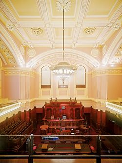 The Supreme Court of Victoria embraces the tradition of the historic building in the recent upgrade works. Court 4 retains the majority of its historic fabric. The design of the central light fitting is based on the original gasolier.