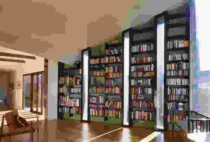 The more passive space of the addition caters sedentary activities and includes the clients' extensive book collection.