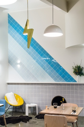Tiles wrap horizon-tally, vertically and diagonally to define dining spaces.