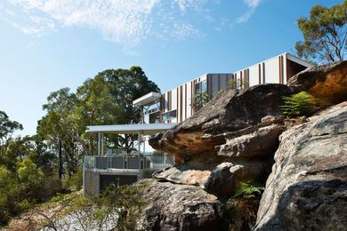 The King Residence perched on a rocky outcrop above Phegan's Bay.