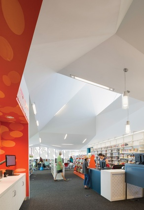 The Pico Branch Public Library is sited within Virginia Avenue Park. Large skylights and shaded glass windows allow views of the park from within the library.