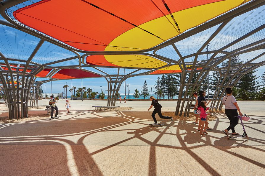 Along the upper promenade, arbours by Chaney Architecture that feature a colour pattern developed in collaboration with Aboriginal artist Sharyn Egan provide a flexible space for events.