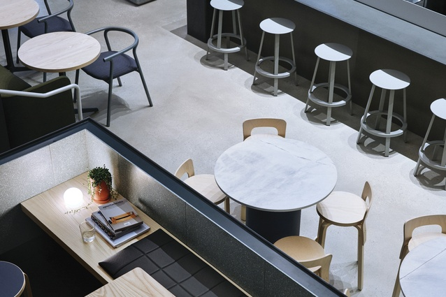 Visitors are given a range of seating options: couches, bar stools and dining tables.