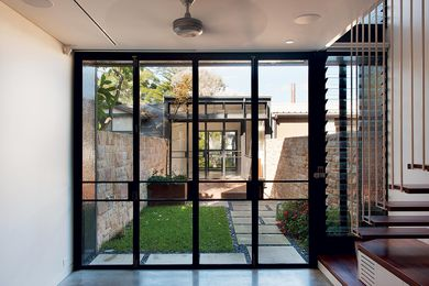 An enclosed courtyard separates the old and new sections of the house.