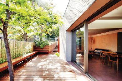 A large opening between the main living space and deck allows a connection with the elements, and for winter sun to penetrate the concrete slab.