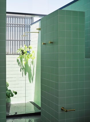 The shower is a glorious, sheltered room contained within a veiled enclosure but open to the elements.