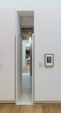 Slots in the gallery walls allow visitors to see through to new spaces or return to old.