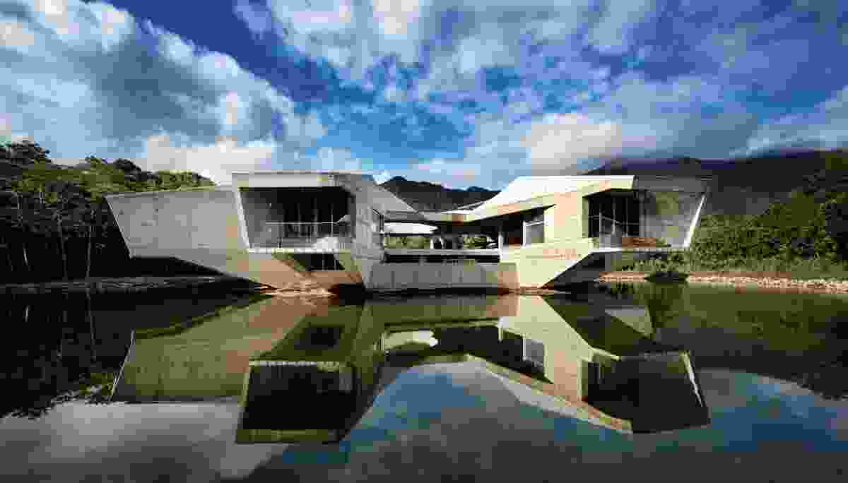 Stamp House is conceived as a topographical intervention in the tropical surroundings of the Daintree Rainforest.