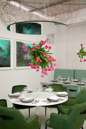 Tulips hang above the dining tables at the  Lexus Design Pavilion.