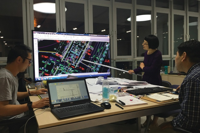 Architects from Cox Architecture and Tianjin Architecture Design Institute resolving design coordination issues between the services and the complex form (2016).