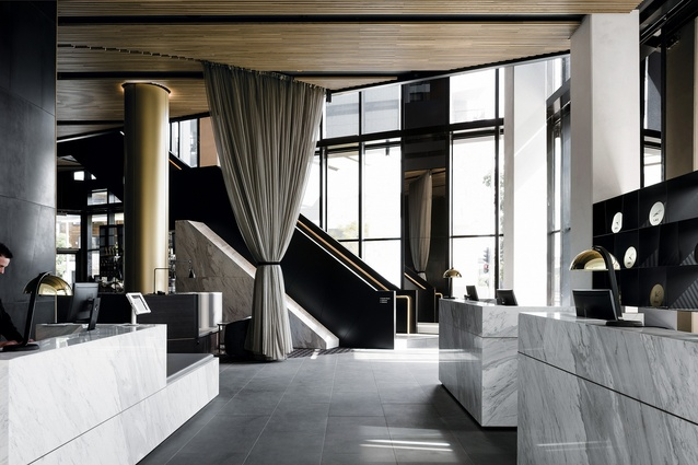 The monolithic welcome desks and grand staircase in the double-height entry space make a grand first impression.